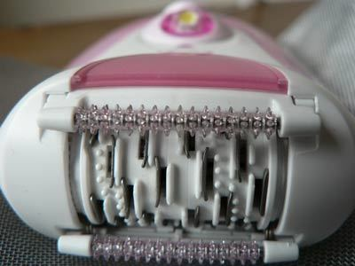 Closeup of epilator showing tweezers