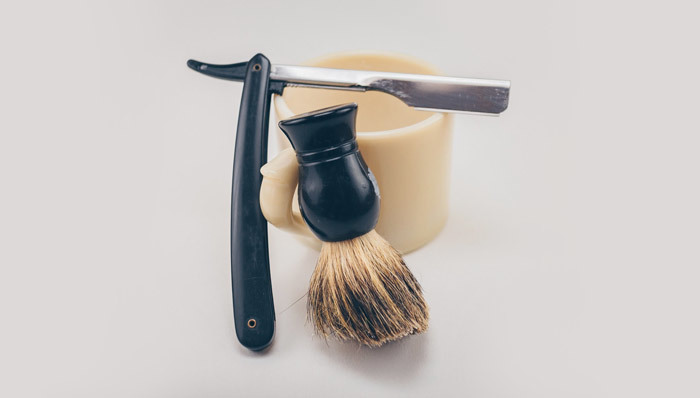 Old fashioned straight razor, brush, and mug