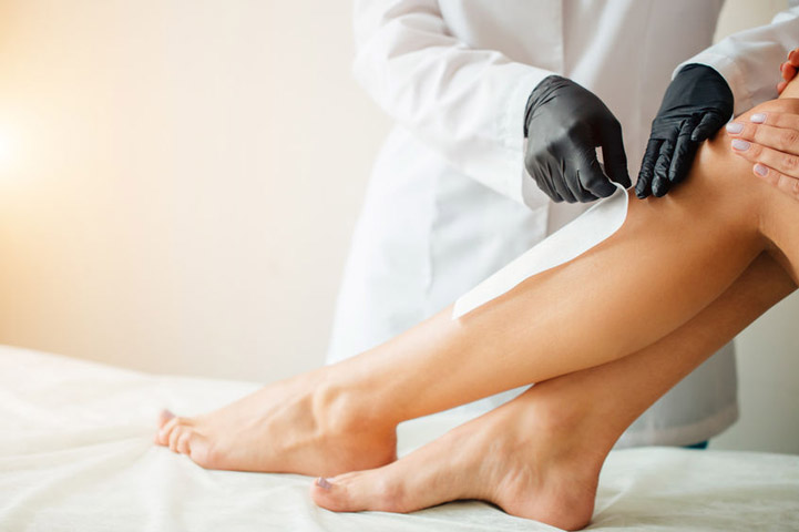 Hair removal with strip in a salon